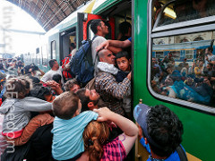 Refugees storm into a train at the Keleti train station in Budapest, Hungary, September 2015https://flic.kr/p/xsbgJV